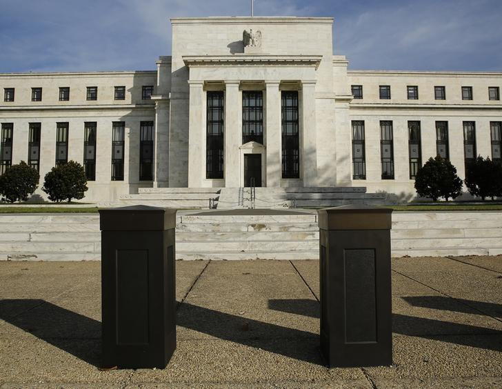 The United States Federal Reserve Board building is shown behind security barriers in Washington