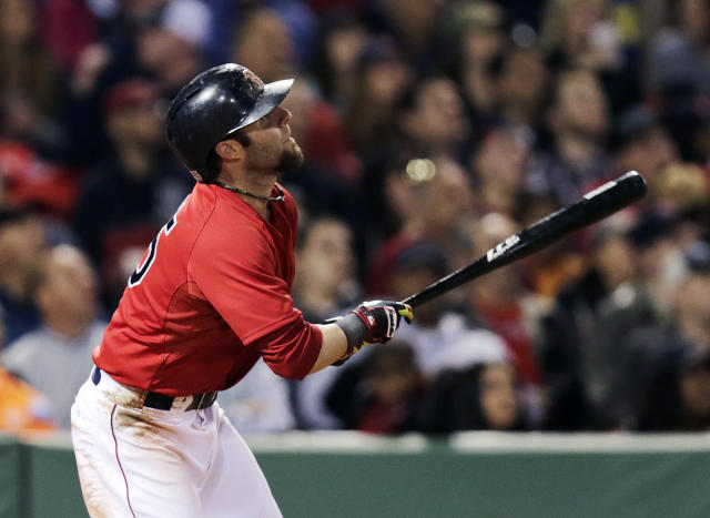 Boston Red Sox's Dustin Pedroia drops his bat while watching the flight of his grand slam off Oakland Athletics pitcher Ryan Cook during the sixth inning of a baseball game at Fenway Park in Boston, Friday, May 2, 2014. (AP Photo/Charles Krupa)