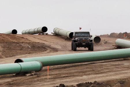 FILE PHOTO: A vehicle drives next to a series of pipes at a Dakota Access Construction site near the town of Cannon Ball