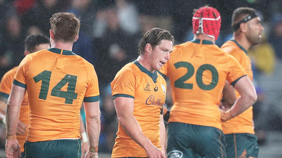 Pictured here, Wallabies players look dejected after their record Bledisloe Cup Test defeat at Eden Park.