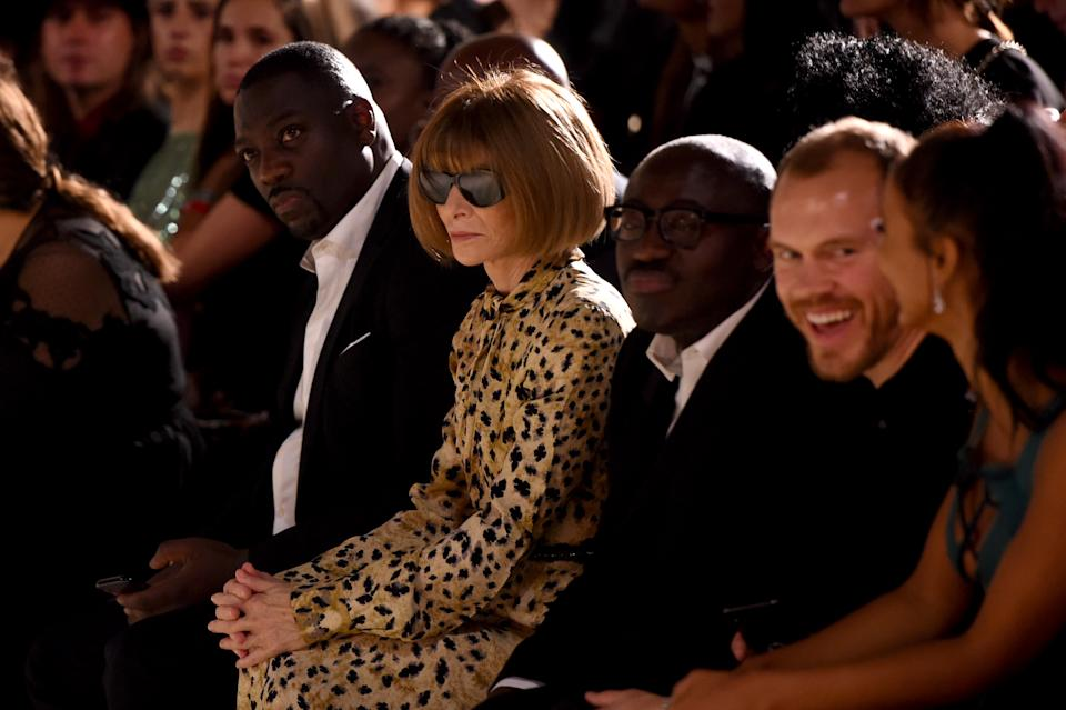 Anna Wintour and Edward Enninful watch from the front row during the Fashion For Relief catwalk show [Photo: Getty Images]