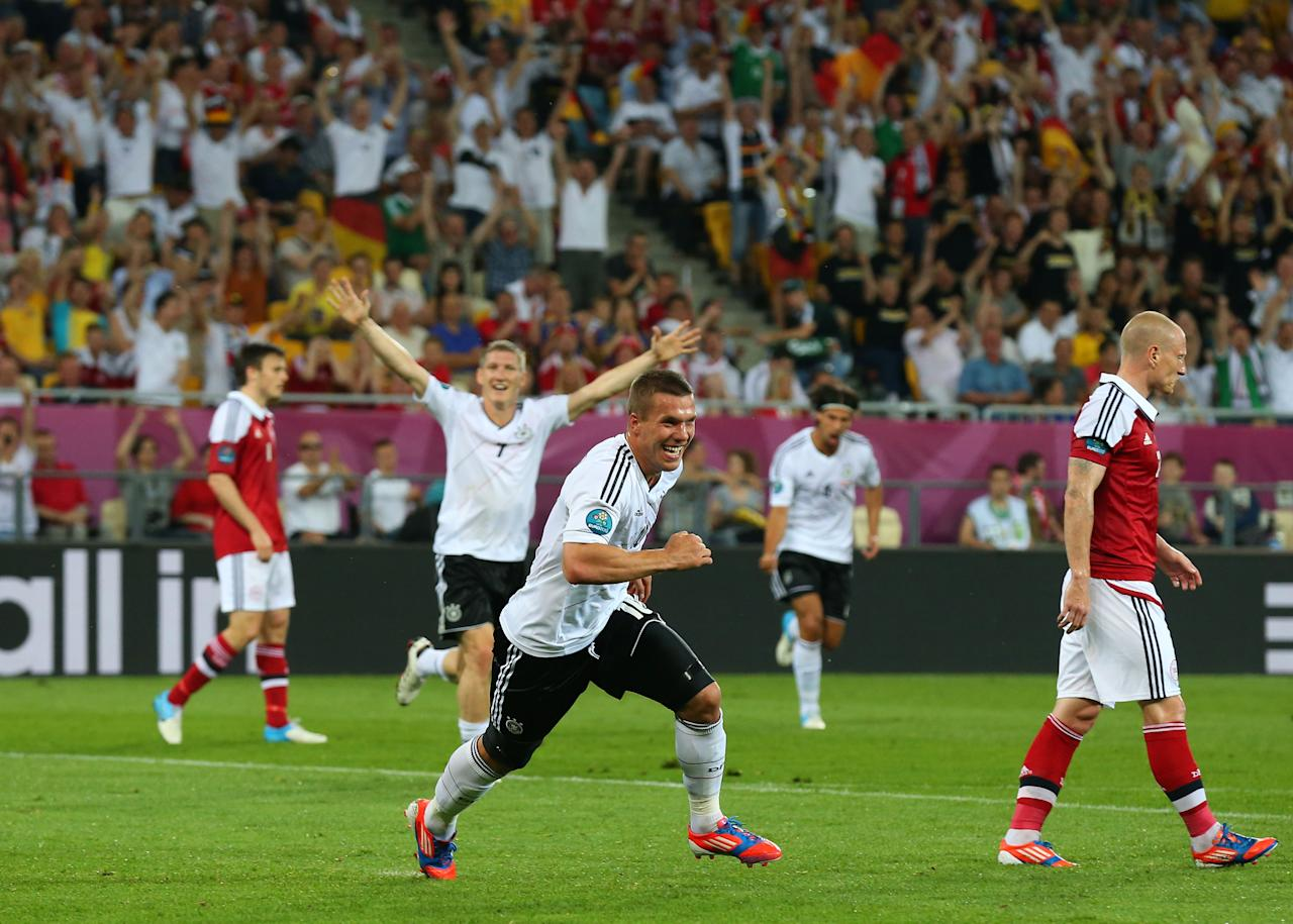 L'VIV, UKRAINE - JUNE 17:  Lukas Podolski of Germany celebrates scoring their first goal during the UEFA EURO 2012 group B match between Denmark and Germany at Arena Lviv on June 17, 2012 in L'viv, Ukraine.  (Photo by Alex Livesey/Getty Images)