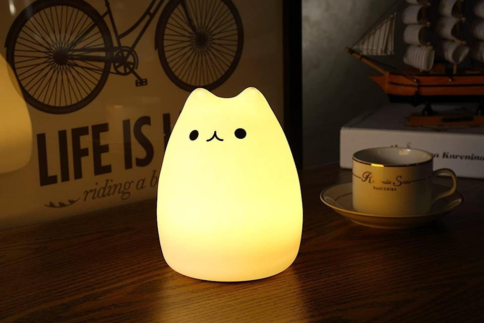 """This little lamp has seven colors and light modes, making it a perfect bedside light for late-night reading or a calming night light to help your little one fall asleep.<br /><br /><strong>Promising review:</strong>""""These kitty lights are<strong>super adorable, super fun and super loved by my kid</strong>. I bought this light as a gift for my daughter for her birthday, she loves it.<strong>The kitty is soft and squishy, the light colors are bright and pretty, and it has good battery life. I loved it so much that I bought another for a friend's daughter.</strong>Great little light."""" —<a href=""""https://amzn.to/3bAc8Ue"""" target=""""_blank"""" rel=""""nofollow noopener noreferrer"""" data-skimlinks-tracking=""""5851345"""" data-vars-affiliate=""""Amazon"""" data-vars-href=""""https://www.amazon.com/gp/customer-reviews/R13RADVYYPET33?tag=bfnusrat-20&ascsubtag=5851345%2C11%2C34%2Cmobile_web%2C0%2C0%2C16315294"""" data-vars-keywords=""""cleaning,fast fashion"""" data-vars-link-id=""""16315294"""" data-vars-price="""""""" data-vars-product-id=""""15943557"""" data-vars-retailers=""""Amazon"""">KMMR<br /><br /></a><strong><a href=""""https://amzn.to/3tYjMOz"""" target=""""_blank"""" rel=""""noopener noreferrer"""">Get it from Amazon for$18.99.</a></strong>"""