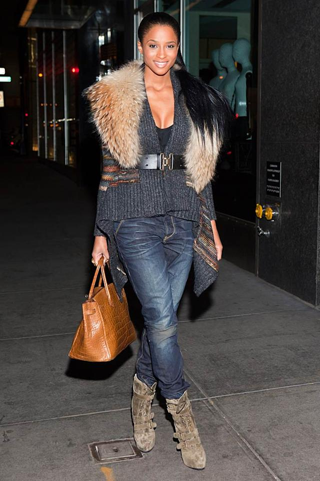 "Every once and a while we like to toss in a pic of a celeb looking cute and casual. This time, it's R&B star Ciara, who was spotted strolling through Manhattan in belted sweater, distressed denim, buckle-adorned booties, and (what we hope was) a faux fur wrap. Michael Stewart/<a href=""http://www.wireimage.com"" target=""new"">WireImage.com</a> - October 17, 2010"