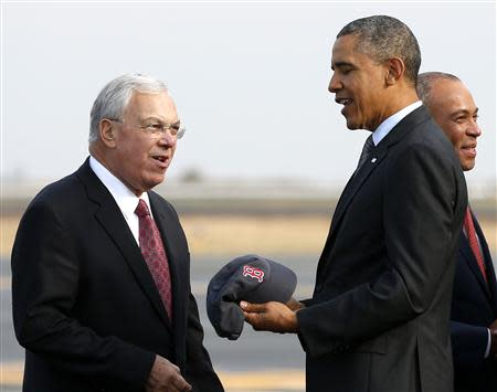 U.S. President Obama is given a Red Sox baseball cap by Boston Mayor Menino upon his arrival in Boston