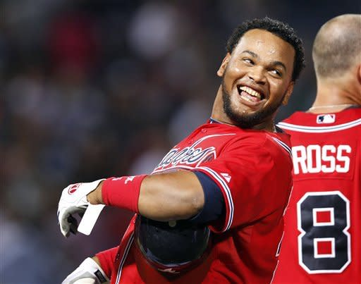 Atlanta Braves pinch hitter Juan Francisco reacts after driving in the game-winning run with a base hit in the 11th inning of a baseball game against the Los Angeles Dodgers, Friday, Aug. 17, 2012, in Atlanta. Atlanta won 4-3.(AP PhotoJohn Bazemore)