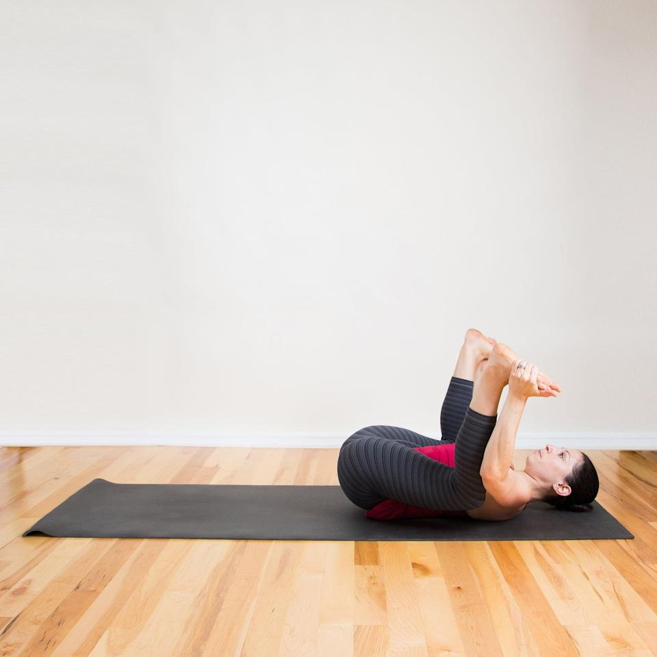 <ul> <li>Lie on your back, bend both knees and hold on to the outside edges of your feet.</li> <li>Gently use your arm muscles to pull your knees toward the floor beside your chest. Relax your shoulders and your head, staying here for 30 seconds.</li> </ul>