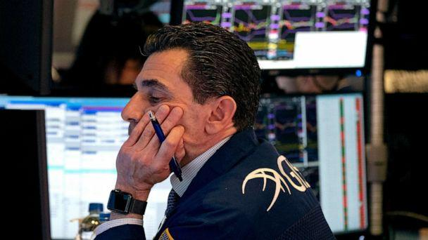 PHOTO: Trader Peter Mazza works on the floor of the New York Stock Exchange, March 16, 2020. (Craig Ruttle/AP)