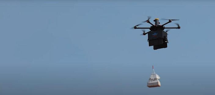 An Air Loco delivery drone delivers food to a hungry customer's house.