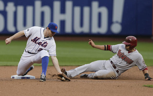 New York Mets second baseman Daniel Murphy (28) takes the throw and tags the bag to force out Arizona Diamondbacks Martin Prado during the sixth inning of a baseball game, Saturday, May 24, 2014, in New York. (AP Photo/Julie Jacobson)