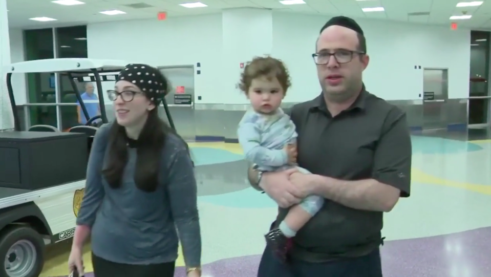 Jenni and Yossi Adler and their 19-mont-old daughter were kicked off the American Airlines flight. Source: WPLG
