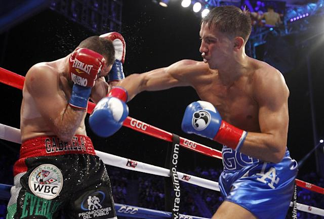 Gennady Golovkin (R) hits Marco Antonio Rubio with a right en route to winning in the second round in October. (AP)