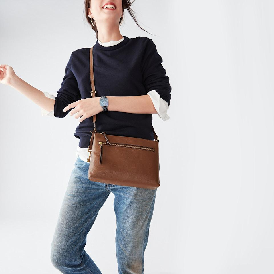 """This will fit the essentials, but not all the random crap you really don't need to be carrying around. Do you really need that receipt for groceries from six months ago?<br /><br /><strong>Promising review:</strong>""""This purse is well worth the price. It's holding up well after 6 months of daily use. It holds my wallet, small makeup bag, two pairs of glasses, and a few extras. It also has four compartments that are good sizes for my phone, receipts, and other flat-ish necessities."""" —<a href=""""https://amzn.to/32nAifm"""" target=""""_blank"""" rel=""""nofollow noopener noreferrer"""" data-skimlinks-tracking=""""5753950"""" data-vars-affiliate=""""Amazon"""" data-vars-href=""""https://www.amazon.com/gp/customer-reviews/R3SMCK96ZLWX66?tag=bfabby-20&ascsubtag=5753950%2C27%2C30%2Cmobile_web%2C0%2C0%2C0"""" data-vars-keywords=""""cleaning,fast fashion"""" data-vars-link-id=""""0"""" data-vars-price="""""""" data-vars-retailers=""""Amazon"""">glenk</a><br /><br /><strong>Get it from Amazon for<a href=""""https://amzn.to/3trVfSf"""" target=""""_blank"""" rel=""""nofollow noopener noreferrer"""" data-skimlinks-tracking=""""5753950"""" data-vars-affiliate=""""Amazon"""" data-vars-asin=""""B0721XVT11"""" data-vars-href=""""https://www.amazon.com/dp/B0721XVT11?tag=bfabby-20&ascsubtag=5753950%2C27%2C30%2Cmobile_web%2C0%2C0%2C15956493"""" data-vars-keywords=""""cleaning,fast fashion"""" data-vars-link-id=""""15956493"""" data-vars-price="""""""" data-vars-product-id=""""18212472"""" data-vars-product-img=""""https://m.media-amazon.com/images/I/51buevKBrML.jpg"""" data-vars-product-title=""""Fossil Women's Fiona Small Crossbody Purse Handbag"""" data-vars-retailers=""""Amazon"""">$61.73+</a>(available in seven colors and patterns).</strong>"""