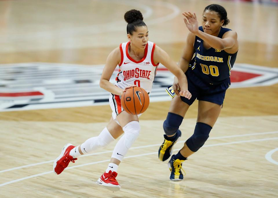Ohio State guard Madison Greene (0) dribbles around Michigan forward Naz Hillmon (00) during the first quarter at Value City Arena in Columbus on Thursday, Jan. 21, 2021.