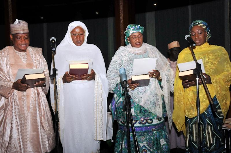 Nigeria's new ministers -- (from left) Defence Minister Brig. Gen. Mansur Dan-Ali; Industry, Trade and Investment Minister Aisha Abubakar; Women's Affairs Minister Aisha Alhassan; and Foreign Affairs Minister Khadija Bukar Ibrahim -- take the oath of allegiance (AFP Photo/)