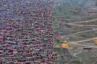 <p>Lurang Gar, once the world's largest Buddhist settlement, is being demolished by authorities in China. (Marco Grassi) </p>