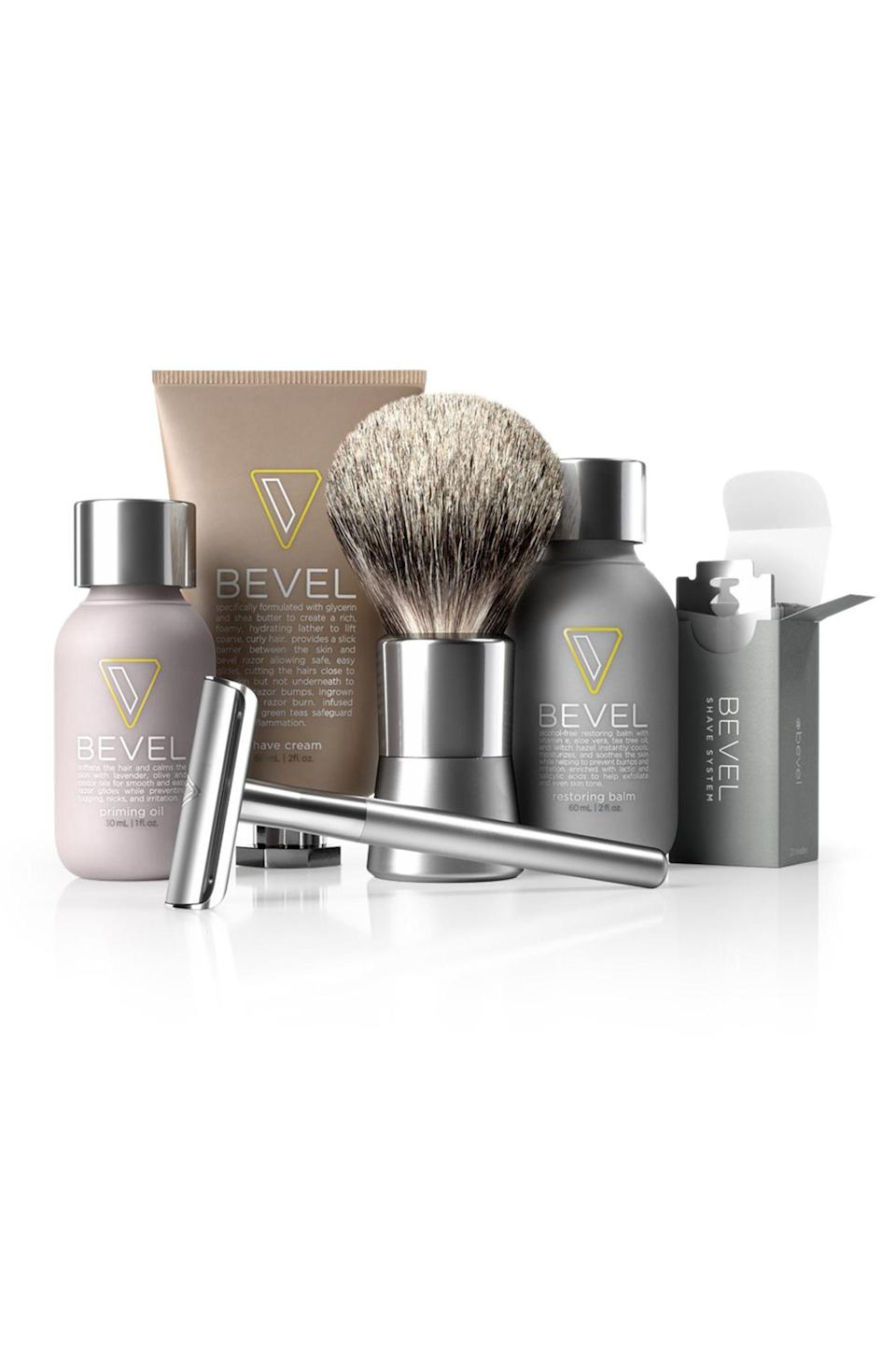 """<p><strong>Bevel</strong></p><p>amazon.com</p><p><strong>$89.99</strong></p><p><a href=""""https://www.amazon.com/dp/B00IT8K564?tag=syn-yahoo-20&ascsubtag=%5Bartid%7C10063.g.34824549%5Bsrc%7Cyahoo-us"""" rel=""""nofollow noopener"""" target=""""_blank"""" data-ylk=""""slk:Shop Now"""" class=""""link rapid-noclick-resp"""">Shop Now</a></p><p>Intro him to his new favorite grooming brand with a set that includes everything from a shave brush to priming oil to a safety razor and more. This shaving kit boasts over 400 reviews, with several mentioning how Bevel's products help prevent razor bumps. </p>"""