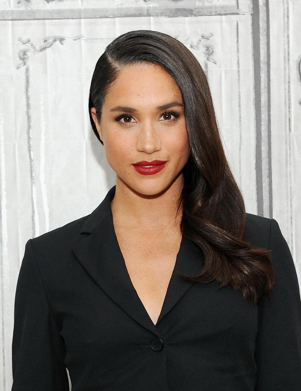 """<p>While discussing her role in """"Suits"""" during a visit to AOL Build, Markle wore soft side-swept waves. (Photo: Desiree Navarro/WireImage) </p>"""