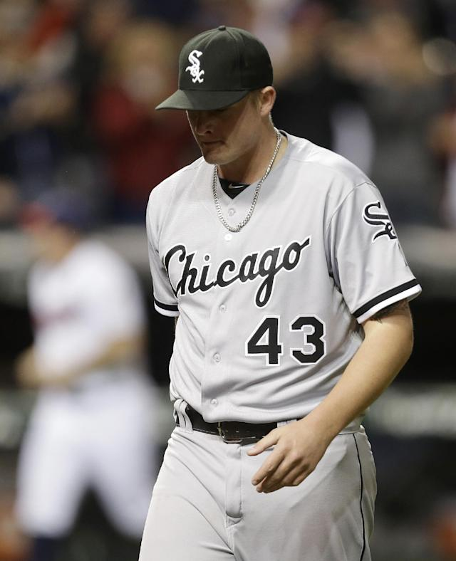 Chicago White Sox relief pitcher Addison Reed walks off the field after giving up a two-run home run to Cleveland Indians' Jason Giambi in the ninth inning of a baseball game, Tuesday, Sept. 24, 2013, in Cleveland. Michael Brantley scored. The Indians won 5-4. (AP Photo/Tony Dejak)