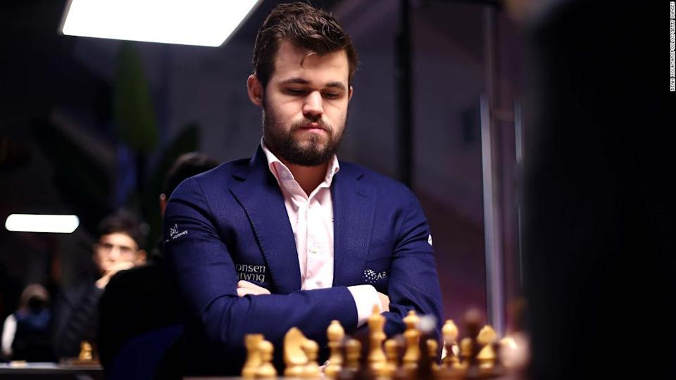 """<p>Carlsen competes against Daniil Dubov during the Tata Steel Chess Tournament in January, 2020. </p><div class=""""cnn--image__credit""""><em><small>Credit: Dean Mouhtaropoulos/Getty Images / Getty Images</small></em></div>"""