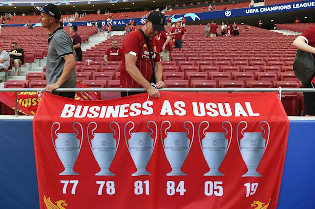 Liverpool fans hang a banner before the UEFA Champions League final. (Photo by PAUL ELLIS / AFP)