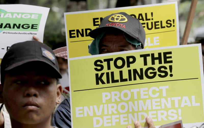 "Environmental activists hold placards during a rally outside the Department of Environment and Natural Resources to coincide with the global protests on climate change Friday, Sept. 20, 2019 at suburban Quezon city, northeast of Manila, Philippines. Various environmental groups in the country are participating in what is expected to be the world's largest mobilization on climate change known as ""Global Climate Strikes.""(AP Photo/Bullit Marquez)"