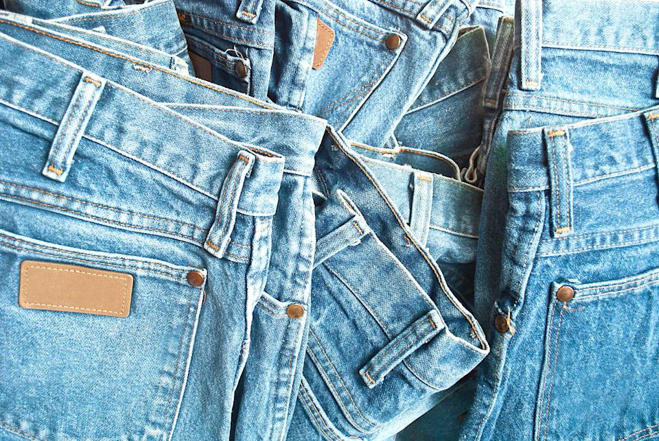 Your jeans-organizational woes making you blue? Hook 'em and hang 'em! (Photo: Getty)