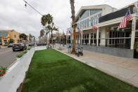 A temporary outdoor space for a restaurant and bar remains empty as new stay-at-home orders begin in Southern California , in San Diego