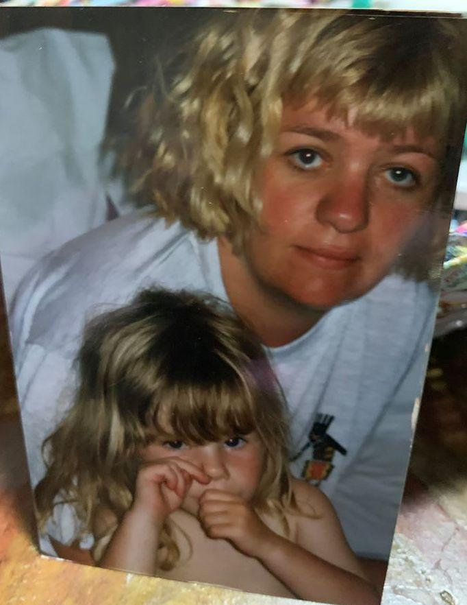 Pictured is an old photograph of Kerry Norton hugging her four-year-old daughter Shani.