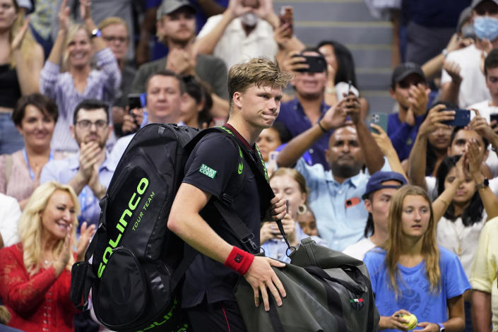 Jenson Brooksby, of the United States, heads off the court after losing to Novak Djokovic, of Serbia, during the fourth round of the US Open tennis championships, Monday, Sept. 6, 2021, in New York. (AP Photo/John Minchillo)