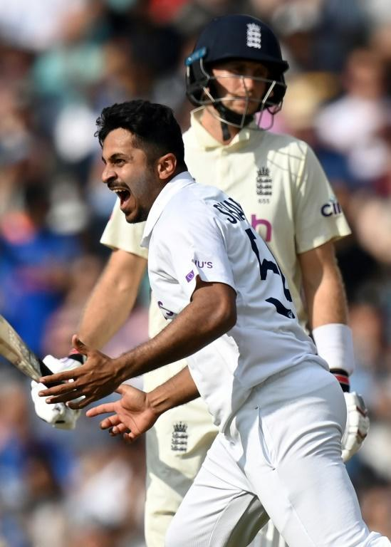 Key wicket: India's Shardul Thakur celebrates dismissing England captain Joe Root in the fourth Test at the Oval (AFP/Glyn KIRK)