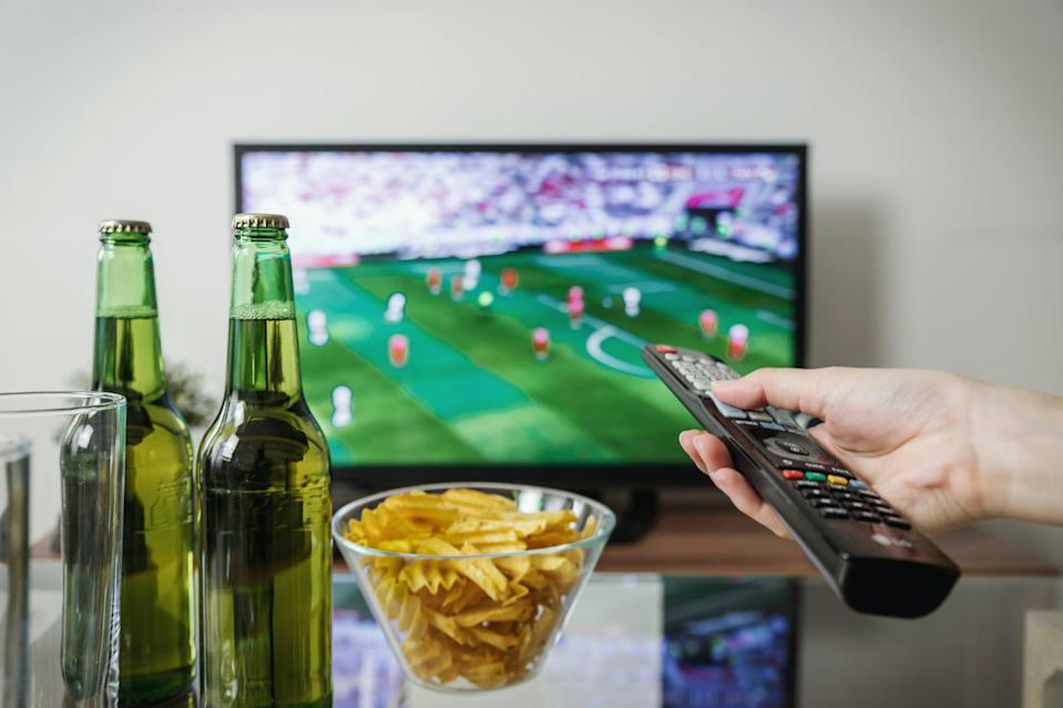 """<p> Because in reality, this is what you'll be doing for Super Bowl Sunday. </p> <p> <a href=""""http://media1.popsugar-assets.com/files/2021/01/26/082/n/1922507/04abbcb966271fce_pexels-jeshootscom-1201996/i/Football-Snacks-Zoom-Background.jpg"""" class=""""link rapid-noclick-resp"""" rel=""""nofollow noopener"""" target=""""_blank"""" data-ylk=""""slk:Download this Zoom background image here."""">Download this Zoom background image here.</a> </p>"""