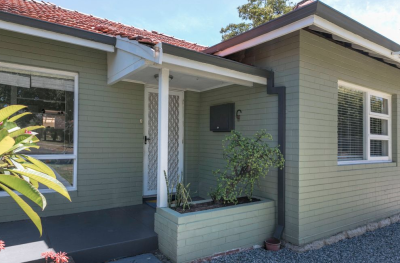 The home is selling for $459,000 and boasts three bedrooms, open plan kitchen and polished jarrah floorboards. Source: realestate.com.au