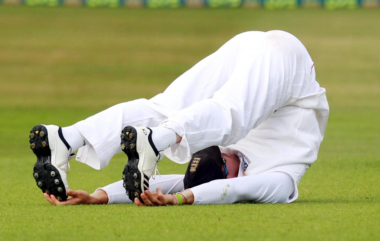 Kevin Pietersen has a stretch during day two of the International Warm up match at The County Ground, Chelmsford.