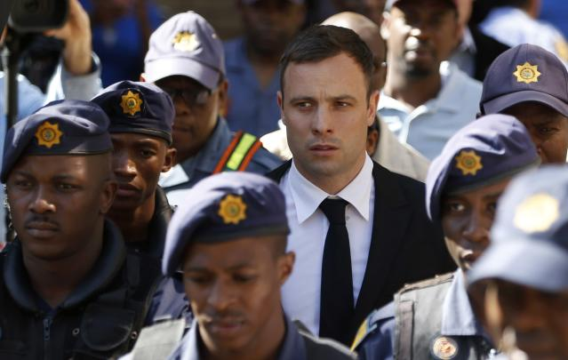 South African Olympic and Paralympic sprinter Oscar Pistorius leaves the North Gauteng High Court in Pretoria, October 16, 2014. Pistorius returned to the court on Thursday on the fourth day of sentencing procedures for the negligent killing of his model girlfriend Reeva Steenkamp. REUTERS/Mike Hutchings (SOUTH AFRICA - Tags: SPORT CRIME LAW ATHLETICS)