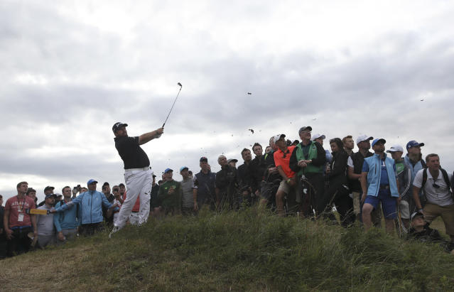 Ireland's Shane Lowry plays out of the rough on the14th hole during the third round of the British Open Golf Championships at Royal Portrush in Northern Ireland, Saturday, July 20, 2019.(AP Photo/Peter Morrison)