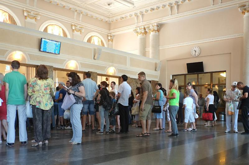 People buy train tickets at the railway station of Donetsk, on July 11, 2014 (AFP Photo/Dominique Faget)
