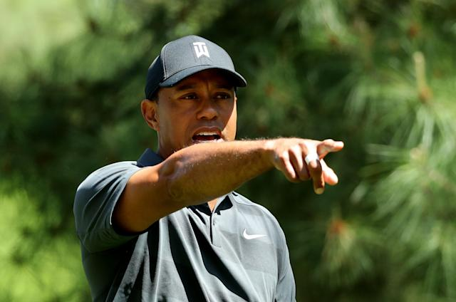 Tiger Woods of the U.S. points to his ball on the 11th fairway during first round play of the 2018 Masters golf tournament at the Augusta National Golf Club in Augusta, Georgia, U.S., April 5, 2018. REUTERS/Lucy Nicholson