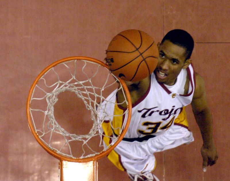 Gabriel Pruitt of USC drives to the basket during 91-58 victory over Southern at the Los Angeles Memorial Sports Arena in Los Angeles, Calif. on Tuesday, Dec. 28, 2004. (Photo by Kirby Lee/Getty Images)