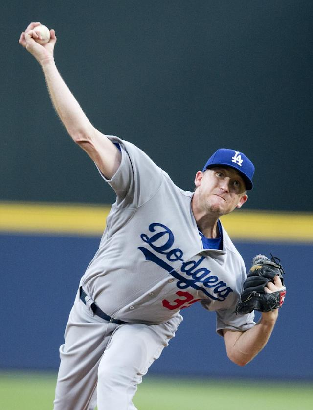 Los Angeles Dodgers starter Kevin Correia works against the Atlanta Braves in the first inning of a baseball game Monday, Aug. 11, 2014, in Atlanta. (AP Photo/John Bazemore)