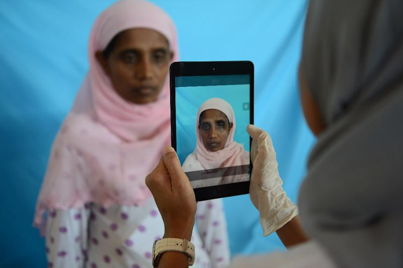 Rohingya woman from Myanmar, Rehana Begum, is photographed during identification procedures by the International Organization for Migration at a confinement area in Langsa, Aceh province on May 19, 2015 (AFP Photo/Romeo Gacad)