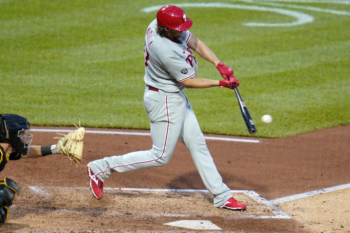 Philadelphia Phillies pitcher Aaron Nola hits an RBI sacrifice fly off Pittsburgh Pirates starting pitcher JT Brubaker during the fifth inning of a baseball game in Pittsburgh, Saturday, July 31, 2021. (AP Photo/Gene J. Puskar)