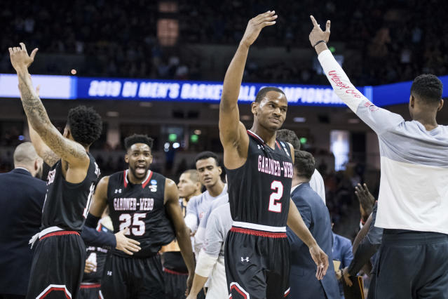 Gardner-Webb forward Eric Jamison Jr. (2) celebrates after a score against Virginia during a first-round game in the NCAA mens college basketball tournament Friday, March 22, 2019, in Columbia, S.C. (AP Photo/Sean Rayford)