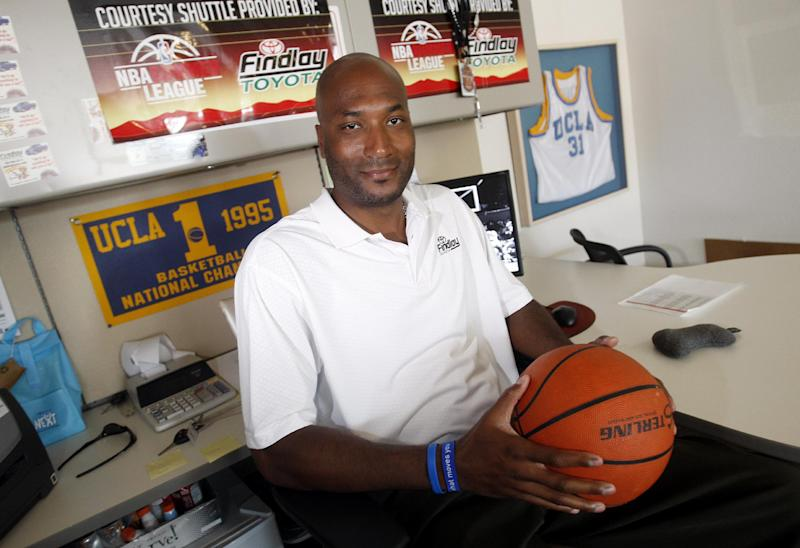 In this Sept. 18, 2010, photo, former UCLA basketball player Ed O'Bannon Jr. sits in his office in Henderson, Nev. Sonny Vaccaro was in search of players who felt wronged when he teamed up with former UCLA basketball star Ed O'Bannon in 2009 to file an antitrust lawsuit against the NCAA over the commercial use of O'Bannon's image. The suit scheduled for trial June 9 in Oakland, Calif., could not only force the NCAA to change the way it does business, but conceivably put it out of business