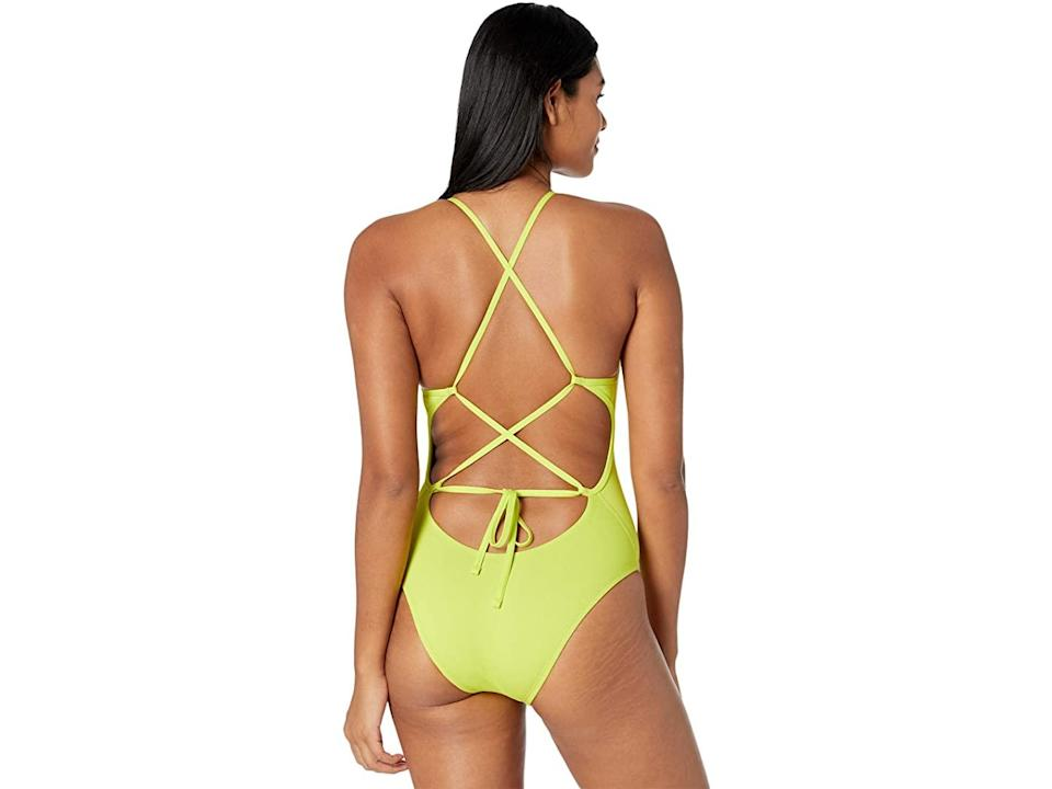"""<br><br><strong>Nike</strong> Hydrastrong Lace-Up Tie Back One-Piece, $, available at <a href=""""https://go.skimresources.com/?id=30283X879131&url=https%3A%2F%2Fwww.zappos.com%2Fp%2Fnike-hydrastrong-lace-up-tie-back-one-piece-cyber%2Fproduct%2F9323109%2Fcolor%2F247889"""" rel=""""nofollow noopener"""" target=""""_blank"""" data-ylk=""""slk:Zappos"""" class=""""link rapid-noclick-resp"""">Zappos</a>"""