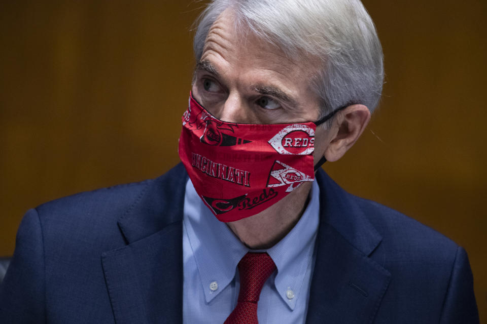 UNITED STATES - JULY 23:  Sen. Rob Portman, R-Ohio, wears a Cincinnati Reds mask during a Senate Foreign Relations Committee ambassador confirmation hearing in Dirksen Building on Thursday, July 23, 2020. (Photo By Tom Williams/CQ-Roll Call, Inc via Getty Images)