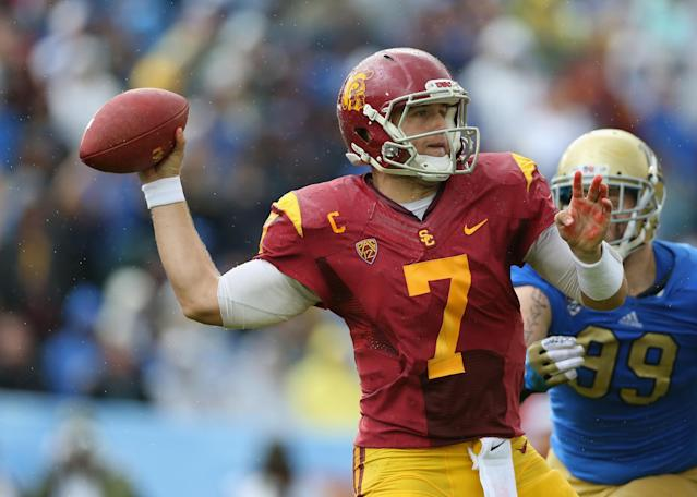 PASADENA, CA - NOVEMBER 17: Quarterback Matt Barkley #7 of the USC Trojans drops back to pass against the UCLA Bruins in the second half at the Rose Bowl on November 17, 2012 in Pasadena, California. UCLA defeated USC 38-28. (Photo by Jeff Gross/Getty Images)