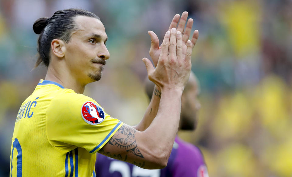 FILE - In this Monday, June 13, 2016 file photo, Sweden's Zlatan Ibrahimovic applauds during the Euro 2016 Group E soccer match between Ireland and Sweden at the Stade de France in Saint-Denis, north of Paris, France. Zlatan Ibrahimovic has come out of international retirement at the age of 39 and is set to play for Sweden for the first time since the European Championship in 2016. The AC Milan striker has been included in Swedens squad for World Cup qualifiers against Georgia on March 25 and Kosovo three days later as well as a friendly against Estonia on March 31. (AP Photo/Christophe Ena, File)
