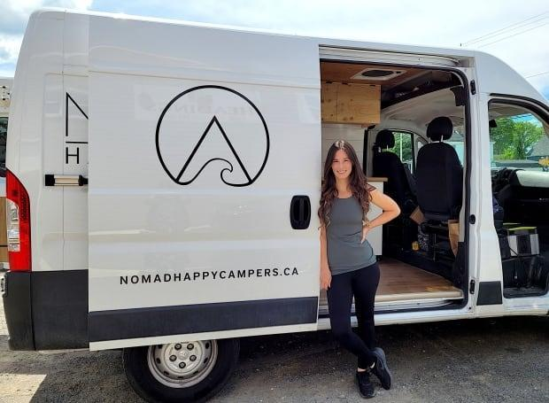 Jacquie Heading stands with her first camper van, Disco. (Brittany Wentzell/CBC - image credit)