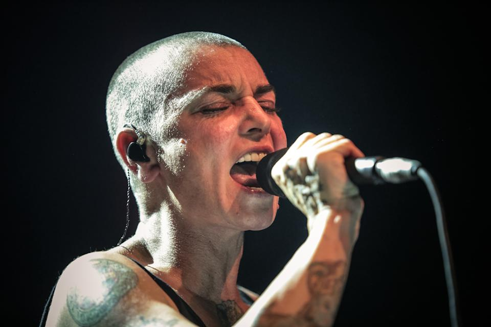 Irish singer Sinead O'Connor, 54, writes in her new memoir, Rememberings, about the shocking incident during which she tore up a photo of Pope John Paul II on Saturday Night Live. (Photo: Christie Goodwin/Redferns via Getty Images)